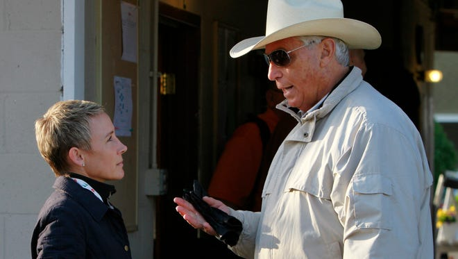 Retired jockey Donna Barton Brothers, left, chats with D. Wayne Lukas during workouts for the Kentucky Derby at Churchill Downs Thursday, April 29, 2010, in Louisville, Ky.