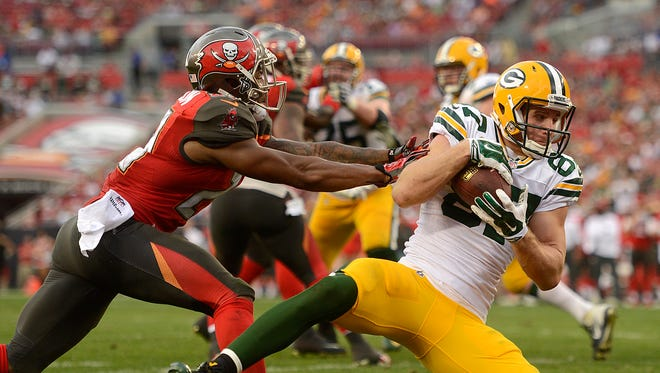 Green Bay Packers receiver Jordy Nelson (87) makes a catch for a touchdown past Tampa Bay Buccaneers cornerback Leonard Johnson (29) in the fourth quarter during Sunday's game at Raymond James Stadium in Tampa, Fla.