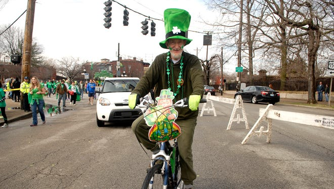 Tom Owen rides his bike in the parade.  March 14, 2015