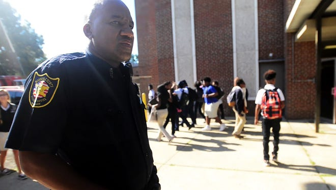 Madison County Sheriff's Deputy and SRO Charlie Yarbrough watches as students change classes in this 2015 file photo at North Side High School.