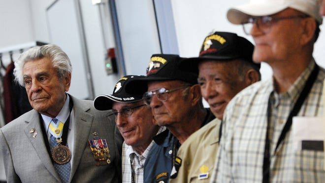 James Megellas, left, poses with fellow veterans at the U.S. Embassy in the Netherlands Sept. 16, 2009.