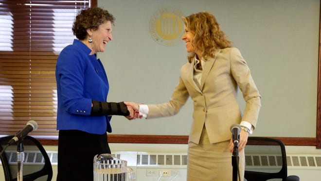 Wisconsin Supreme Court justice candidates JoAnne Kloppenburg, left, and Rebecca Bradley shake hands after appearing at Milwaukee Bar Association forum on Wednesday in Milwaukee. The two candidates made statements, and took questions from the audience and moderator.