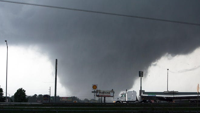 A tornado moves through Tuscaloosa, Ala., on  Wednesday, April 27, 2011. A wave of severe storms laced with tornadoes strafed the South that day, killing at least 16 people around the region and splintering buildings across swaths of an Alabama university town.