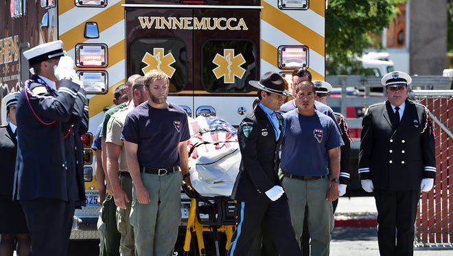 The bodies of two BLM firefighters who died in a Sunday crash arrive at the medical examiner and coronor's office in Reno on July 11, 2016. A procession of firefighters escorted the bodies from Winnemucca to Reno.