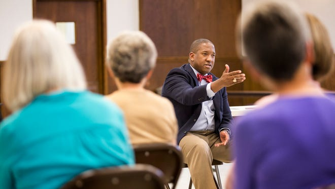 """Jeremy Collins speaks during a """"Forum for Peace"""" at Grace United Methodist Church in Wilmington on Sunday afternoon."""