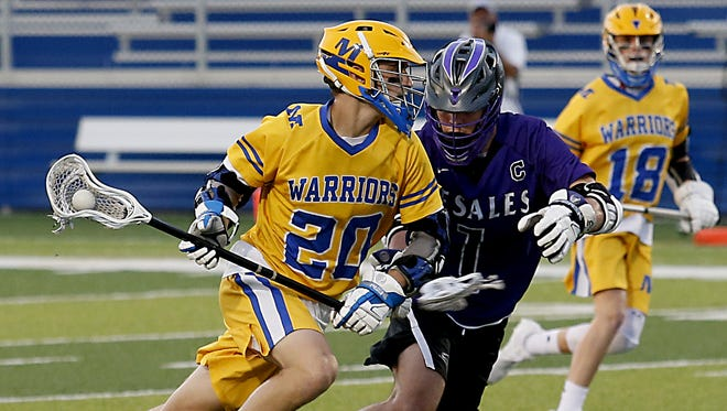 Mariemont middie Wally Renie is covered by DeSales middie Carter Hilleary during their Division II boys lacrosse state semifinals at Roger Glass Stadium in Dayton Tuesday, May 29, 2018.