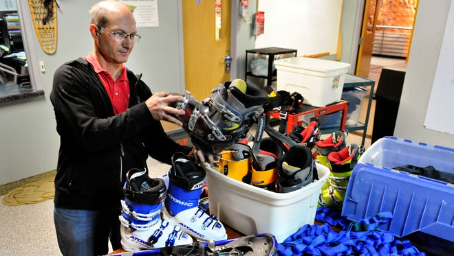 Dave Bacharach organizes equipment Nov. 3 at St. Cloud State University's Outdoor Endeavors in Halenbeck  Hall for the annual ski swap meet. While those with equipment to swap will show up the day of the event, Bacharach has accumulated some items already.