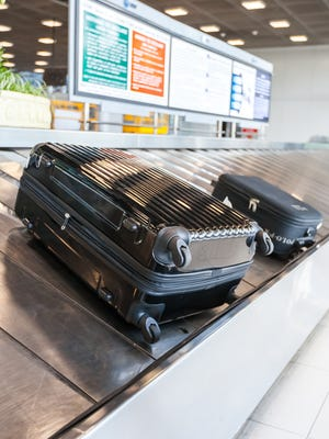 A four-wheeled rolling suitcase is less likely to get tossed around by airline baggage handlers.
