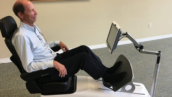 VibeTech Inc. of Sheboygan has released the second generation of their physical therapy product, which use vibration technology to stimulate muscles in the legs and thighs. Pictured, company CFO Ed Morgan demonstrates the chair.