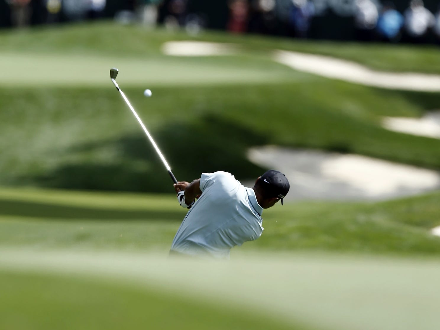 Tiger Woods hits his approach shot during his first round at Oak Hill for the PGA Championship.