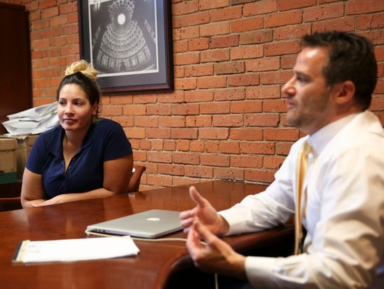 Sherielee Figueroa listens to her attorney, Anthony