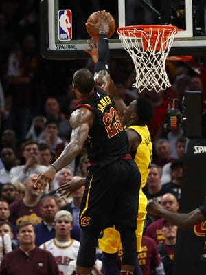LeBron James blocks Victor Oladipo in the closing seconds of Game 5.