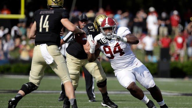 File-This Sept. 23, 2017, file photo shows Alabama defensive lineman Da'Ron Payne (94) pressuring Vanderbilt quarterback Kyle Shurmur (14) in the first half of an NCAA college football game in Nashville, Tenn. (AP Photo/Mark Humphrey, File)