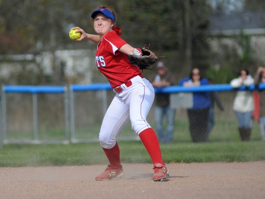 Saints' Jacque Macker tosses a ground ball to first