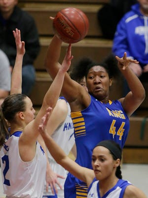 Rufus King sophomore Sydnee Roby (44) passes to a teammate during their WIAA sectional game  March 4. Rufus King beat Oak Creek, 63-52.