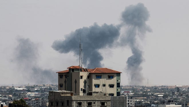 A picture taken from Rafah in the southern Gaza Strip on May 29, 2018, shows smoke billowing over buildings following an Israeli air strike on the Palestinian enclave.