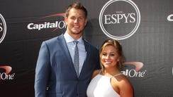Former Olympic gymnast Shawn Johnson East and her husband