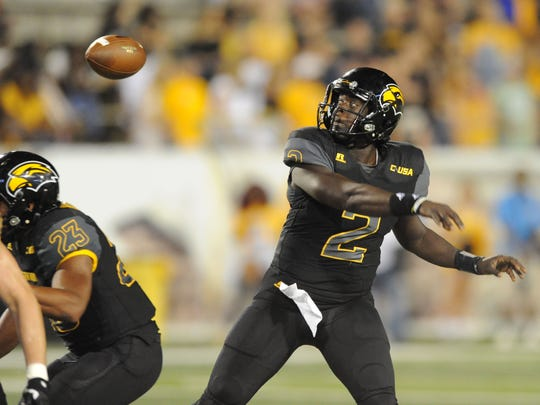 Southern Miss quarterback Keon Howard looses control