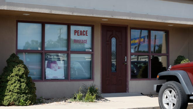 Peace Massage at 3029 E. Sunshine St. is one of more than a dozen Asian massage parlors in Greene County raided as part of a sex trafficking probe on Thursday.