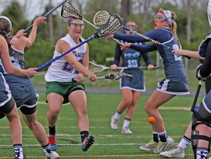 The undefeated Sycamore Lady Aves scored early and often in a convincing 14-1 lacrosse win against Mount Notre Dame, May 1. Here senior midfielder, Ashley Bonnoitt, rips a shot into the goal in spite of multiple MND defenders.