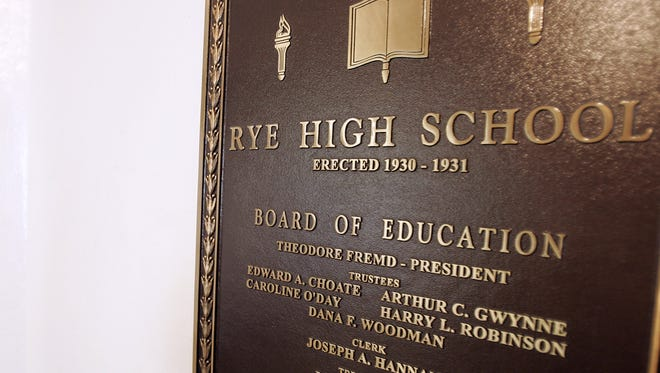 A plaque near an entrance to Rye High School.
