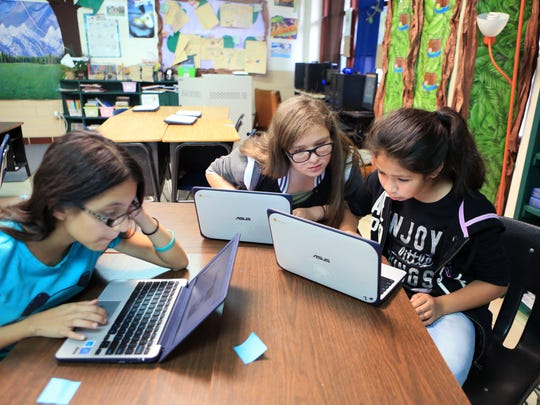 Jefferson Intermediate School students Jaylin Garza, 11 (from left), Violet Amaya, 11, and Hannah Gutierrez, 12, work on their computers in class on Friday, Dec. 2, 2016, in Beeville. The school district has integrated a new computer science program throughout the district.