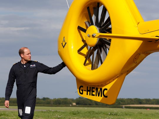 Prince William posed at his helicopter after beginning