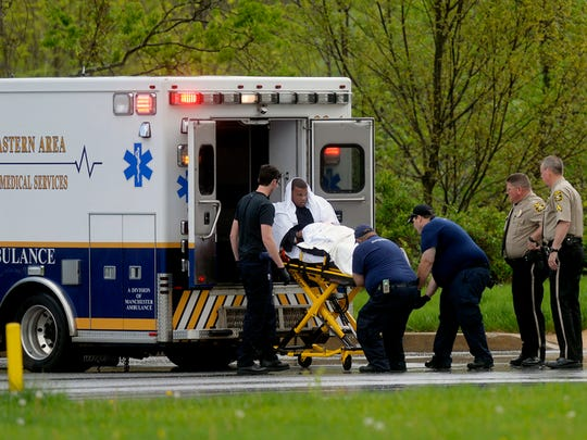 In this file photo from May 6, 2015, Eduardo Portell-Llanos is loaded into an ambulance. He shot at Northern York County Regional Police Officer Isaiah Emenheiser, who returned fire, striking him in the buttocks.