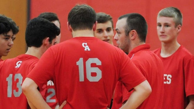 Canandaigua boys volleyball coach Steve Verbridge, right, says he's not sure what to tell his players.