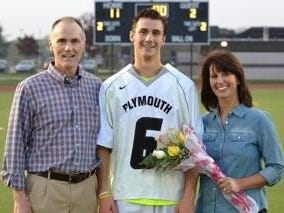On Senior Night, Plymouth's Ben Stover (No. 6) is flanked by parents Randy and Janet Stover.