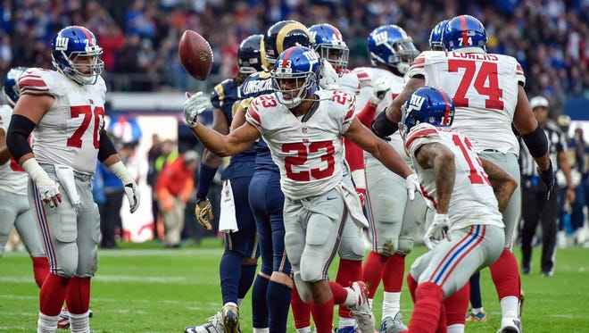 Running back Rashad Jennings (23) of the New York Giants celebrates his 4th quarter winning touchdown during the game between the Los Angeles Rams and the New York Giants at Twickenham Stadium.