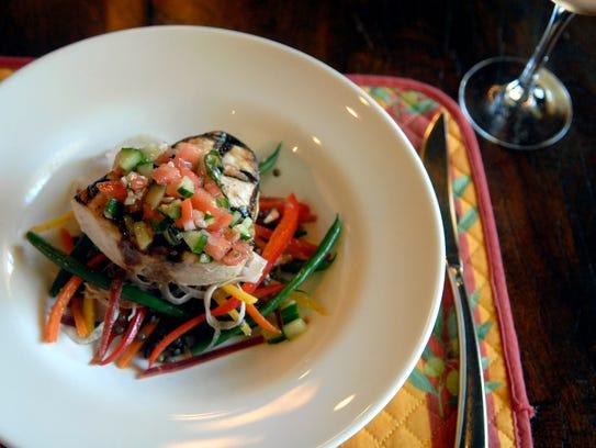 Swordfish meridionale with lentil salad and Mediterranean
