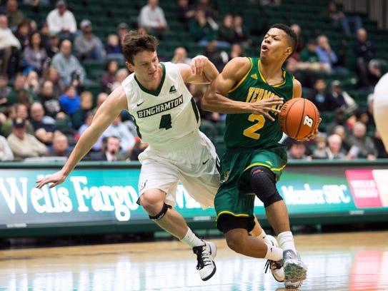 Binghamton University guard Timmy Rose fouls Vermont's