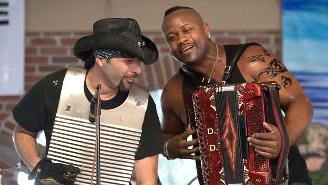 Dwayne Dopsie, right, and Paul LaFleur of the Zydeco Hellraisers perfom at Music & Market in Opelousas.