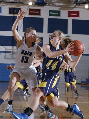 Brenna Wirth, right, and Pewamo-Westphalia jumped up four spots to No. 6 in Class C in the final Associated Press girls basketball poll of the season.