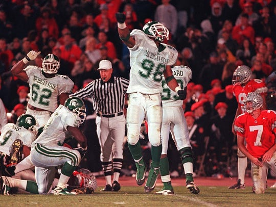 Good times in 1998: MSU's Julian Peterson, center, celebrates his sack of Ohio State quarterback Joe Germaine, right, and the forced fumble that the Spartans recovered in their 28-24 win in Columbus, Ohio.