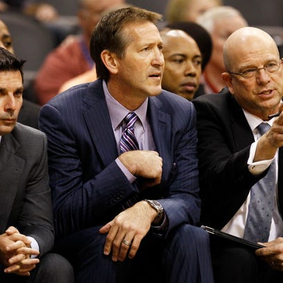 Phoenix Suns head coach Jeff Hornacek is flanked by