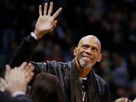 NBA Hall of Famer Kareem Abdul-Jabbar greets fans as he in introduced before a Bucks game earlier this year.