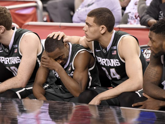 MSU's Tum Tum Nairn Jr. and Gavin Schilling react after