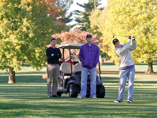 Tim Conley, left, and Michael Cameron, center, watch on as Justin Anderson, right, hits a fairway shot at Grandview Golf Course during a Charity Golf Outing to raise money on behalf of Cameron Carico, a Johnston student who took his own life. The three golfers regularly golfed with Cameron and are also the the organizers of the event. Their foursome only included three players in memory of Cameron.