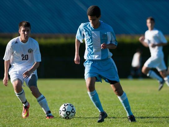 South Burlington's Aiman Ginawi (7) plays the ball