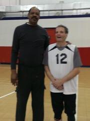 John Protolipac met former NBA superstar Artis Gilmore,