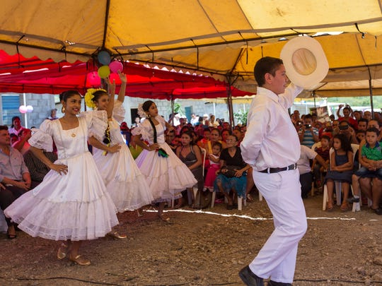 Dancers in traditional costumes performed Nicaraguan folk dances during the dedication ceremonies for the Rainbow Network housing projects.