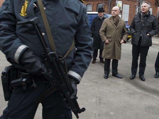 French Interior Minister Bernard Cazeneuve, second
