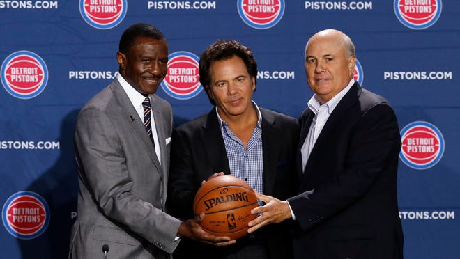 Detroit Pistons new head coach Dwane Casey, left, owner Tom Gores, center, and senior adviser Ed Stefanski pose during an  NBA basketball news conference in Detroit, Wednesday, June 20, 2018. (AP Photo/Paul Sancya)