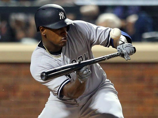Yankees starting pitcher Luis Severino (40) bunts for