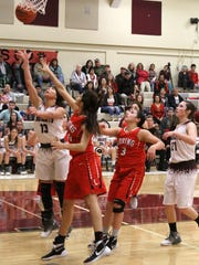 Tularosa's Cassie Vickery makes a layup during the second-half Thursday night.