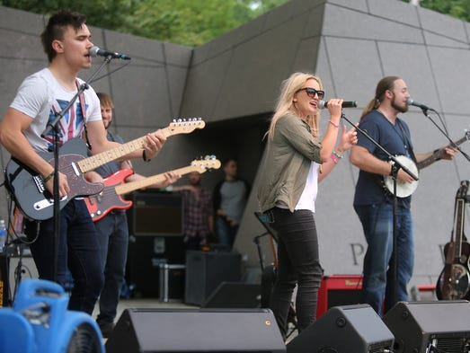 Jamie Lynn Spears and her band performs on the first day of the Buckle Up Music Festival.