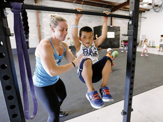 Former UTEP soccer player Holly Cohen Mata helps Brayden