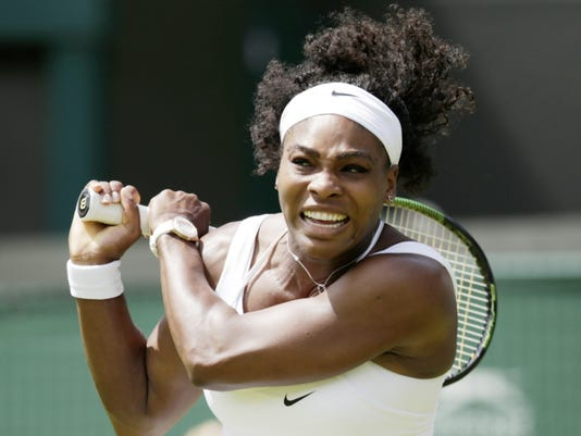Serena Williams plays a return to Margarita Gasparyan during their women's singles first round match Monday at the All England Lawn Tennis Championships in Wimbledon, London. Williams won 6-4, 6-1.